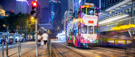 Hong Kong – 20 May 2019: Traditional double decker tram and night city view