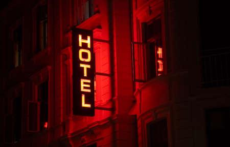 Illuminated hotel sign at night