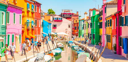 Burano, Italy - 2 June, 2021: Water canal and colorful houses on Burano island 에디토리얼