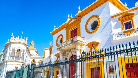 Seville, Spain - 3 July, 2021: Facade of bullfighting arena Plaza de Toros Real Maestranza in Sevilla old town