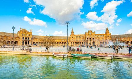 Sevilla, Spain – 15 March, 2021: Spanish Square (La Plaza de Espana) and water canal scenic view 에디토리얼