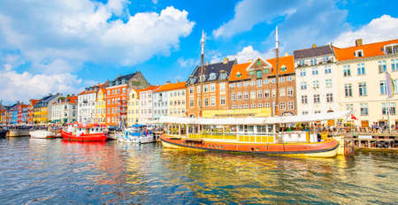 Copenhagen, Denmark - 30 July, 2021: Nyhavn harbour and water canal in old town 에디토리얼