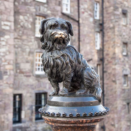 Edinburgh, Scotland - 11 September, 2021: Greyfriars Bobby dog monument, who became known for spending 14 years guarding the grave of his owner.
