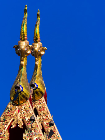 nagara: Elegant and uniquely golden tiled gable apex of Thai temple s rooftop  Stock Photo
