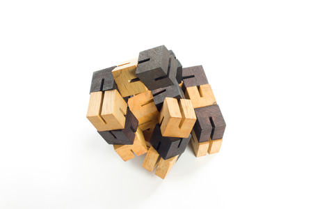 dexterity: wooden game block on white background