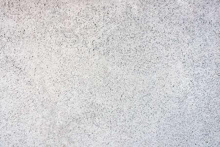 斑点の背景に白い壁、任意の目的のためのテクスチャ 写真素材
