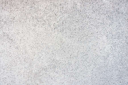 White wall in speckles background, textur for any purposee