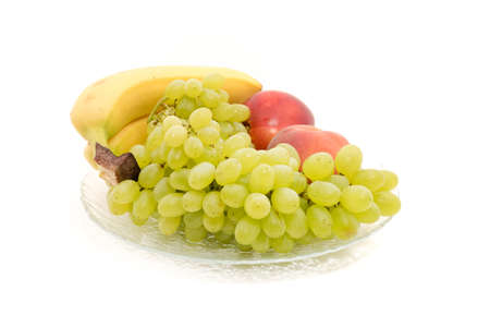 Bananas, grapes, peaches, nectarines, on a plate for any purpose Stock Photo