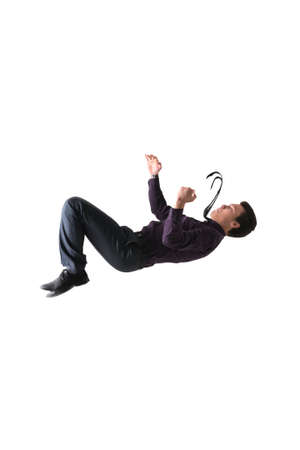 A man performs flip upside down in a suit and tie isolated on white background for any purpose Stock Photo