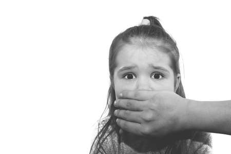 Scared little girl with an adult mans hand covering her mouth for any purpose