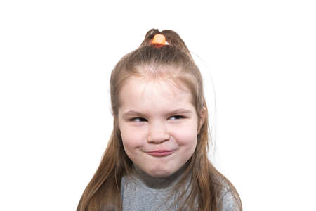 Beautiful little girl looks suspiciously isolated on white background for any purpose Stock Photo