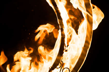 Beautiful flames, on a decorative grille, in the dark, for any purpose Stock Photo