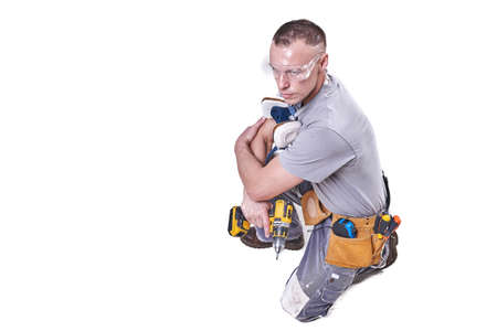 Master Builder-finisher in work clothes. Isolated on white background for any purpose