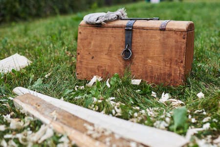 Medieval chest with a handkerchief standing on the grass for any purpose