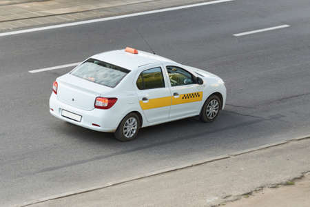 Taxi, white with yellow stripe, rear view for any purpose