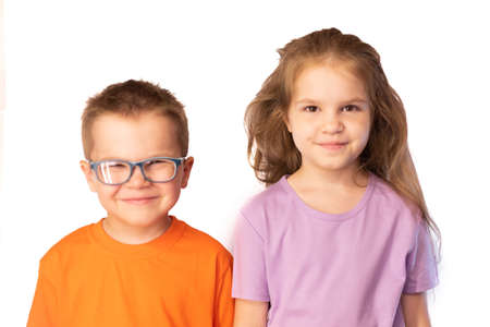 Little cute boy and girl smiling, isolated on white background for any purpose