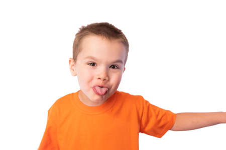 Cute little boy funny shows tongue isolated on white background for any purpose