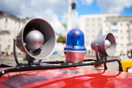 Flashing lights and sirens on the roof of an old police car for any purpose Stock Photo