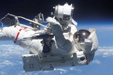 Astronaut in a spacesuit at the space station. Elements of this image were furnished by NASA for any purpose 免版税图像