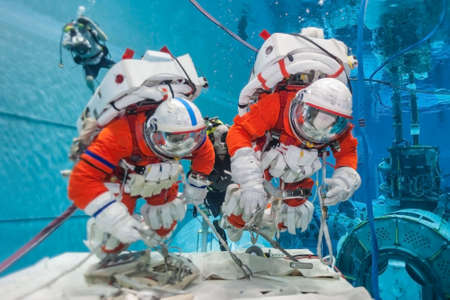 Cosmonaut training in the pool, in spacesuits.Elements of this image were furnished by NASA for any purpose 版權商用圖片