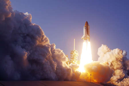 Space Shuttle Launch. With fire and smoke. Against the background of blue sky. Elements of this image were furnished by NASA. For any purpose. Imagens