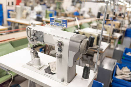 Industrial sewing machine in the work shop. Shoe manufacturing. For any purpose. Zdjęcie Seryjne