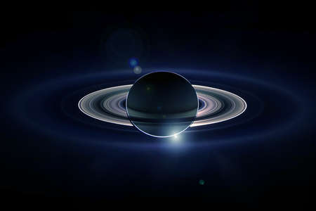 Planet Saturn, with rings, and in the rays of the sun.