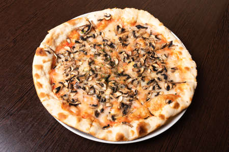Bad, cheap pizza with mushrooms and cheese. For any purpose.