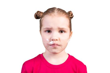Girl with a sealed mouth. Isolated on a white background.