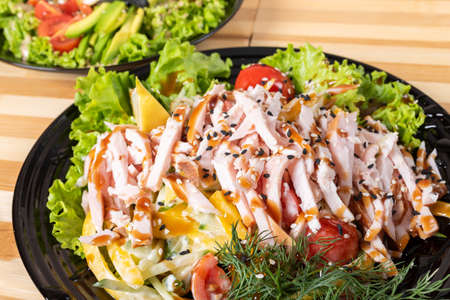 Japanese chicken salad on a black plate. For any purpose. Standard-Bild - 134959274
