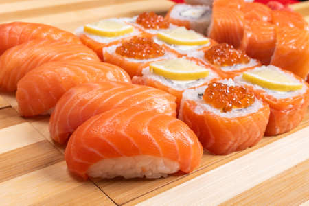Sushi set with salmon. Philadelphia., with caviar. With ginger and wasabi. Close-up. For any purpose.
