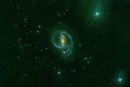 A green galaxy in deep space.
