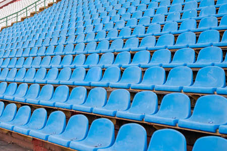 Dirty seats at the stadium without the visitors. For any purpose.