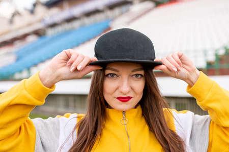 Girl in a cap at an empty stadium Фото со стока - 146873988