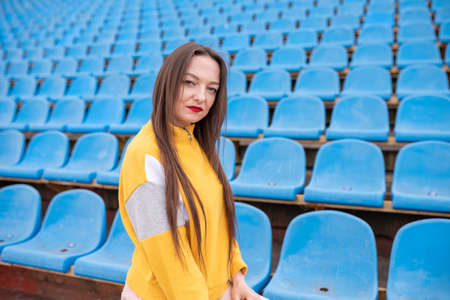 Girl alone in an empty stadium.