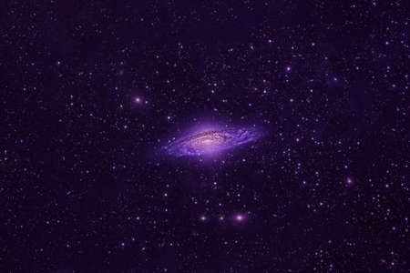 A pink galaxy in deep space.