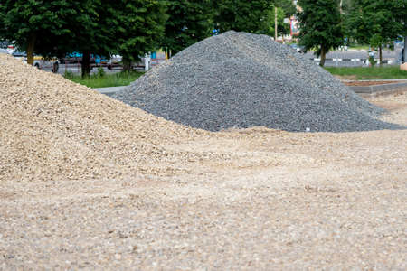 Two heaps of gravel, yellow and gray