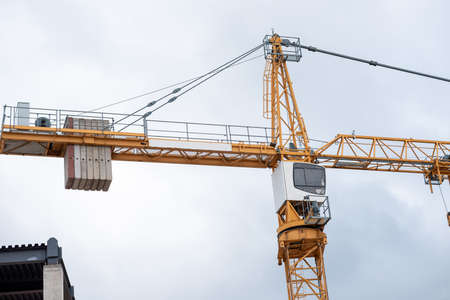 crane in the city in cloudy weather.