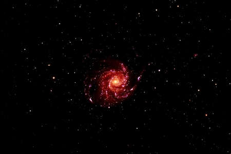 Spiral galaxy on a dark background.