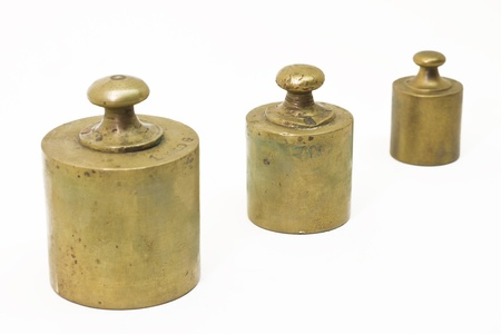 Three antique weights isolated on white photo