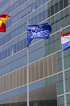 European flag with modern building on the background photo