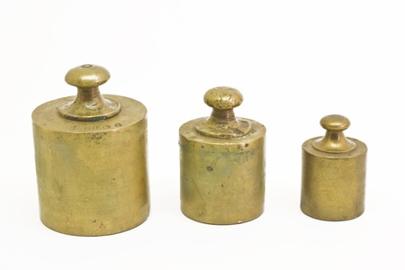 antique weight scale: Three antique weights isolated on white Stock Photo