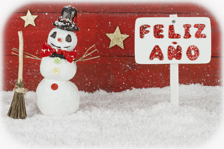 One snowman with a signpost with the words Happy New Year on spanish photo