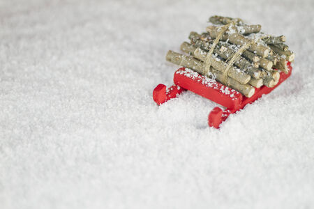 Red sleigh on the snow photo