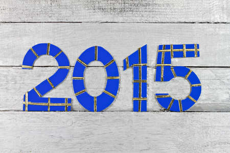 Year 2015 numbers on a silver painted clapboard photo