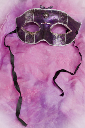 masquerade costumes: Carnival mask on purple and pink background