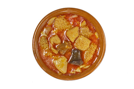 Spanish callos in an earthenware dish isolated on white