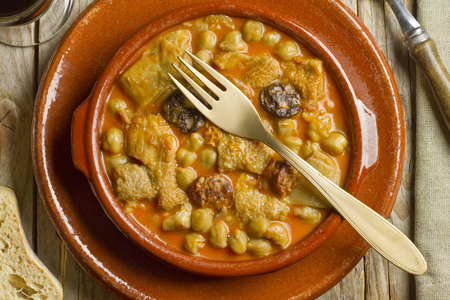 Spanish callos with chickpeas with a golden fork