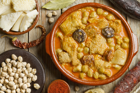 Spanish callos with chickpeas on a wooden table