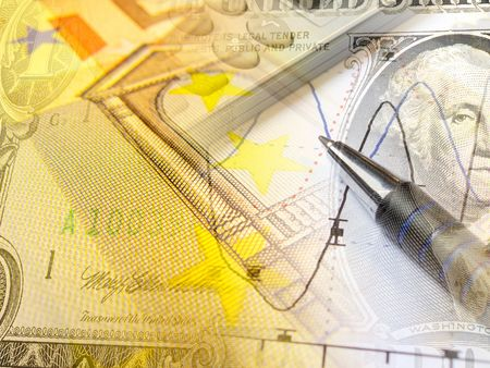 A pen and calculator with banknote - abstract business background.